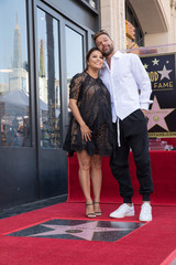 Eva Longoria and Ricky Martin pose on the Hollywood Walk of Fame in Los Angeles