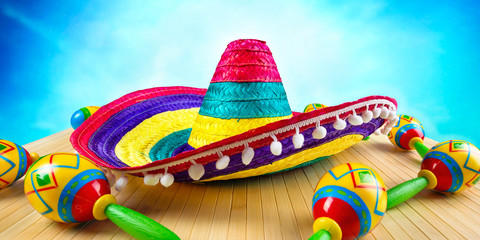 Mexico.Colored sombrero and maracas on a wooden background.