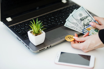 Close-up woman buying online with cryptocurrency concept, woman holding golden crypto coin