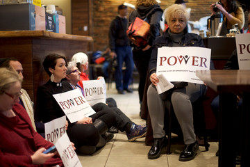 Interfaith clergy leaders stage a sit-in at the Center City Starbucks, where two black men were arrested, in Philadelphia, Pennsylvania