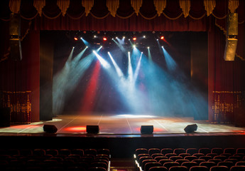 scene, stage light with colored spotlights and smoke Fototapete