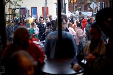 Protestors assemble outside the Center City Starbucks, where two black men were arrested, in Philadelphia, Pennsylvania