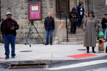 Onlookers gather across the street from the Center City Starbucks, where two black men were arrested, in Philadelphia, Pennsylvania