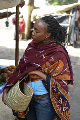 Woman holding a basket in the market