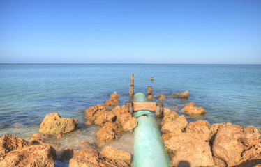 Drainage pipe leads into the ocean at Lowdermilk Beach