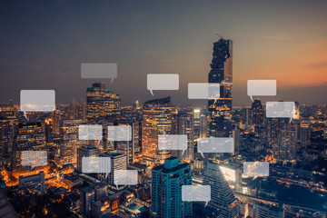 Wall Mural - city scape with speech icon,technology communication concept