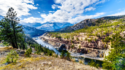 The famous Fraser Canyon Route following the Thompson River as it flows through the snow covered mountains of the Coastal Mountain Range in western British Columbia, Canada