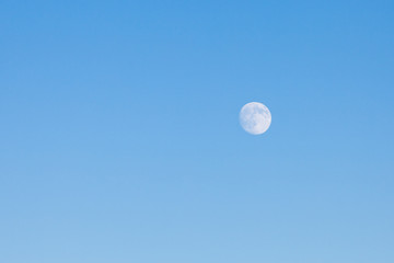 Full moon in blue sky. Nature background