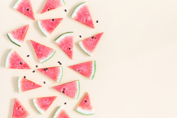 Watermelon pattern. Red watermelon on yellow background. Summer concept. Flat lay, top view, copy space