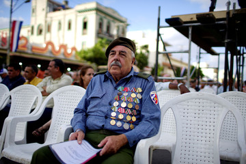 Cuban veteran who fought against the U.S.-backed Bay of Pigs invasion, Jorge Delgado, 73, waits for the beginning of the ceremony to mark the 57th anniversary of the declaration of the socialist character of the Cuban Revolution in Havana