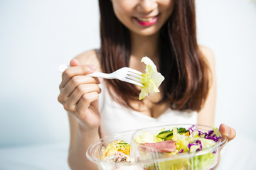 Young women eating salad
