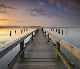 Calm Lake at Sunrise, Long Wooden Pier