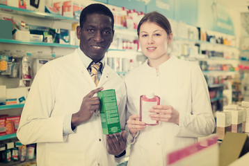 two confident apothecaries offering medication