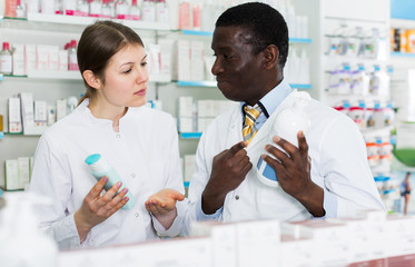 Two pharmacists discussing in pharmacy