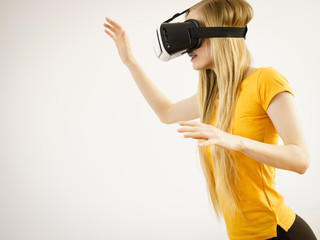 Girl wearing virtual reality goggles.