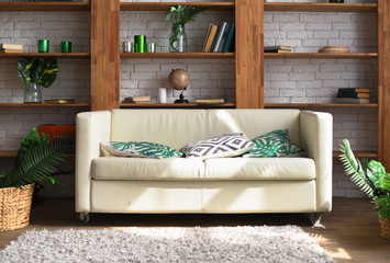 White leather sofa in a tropical style room
