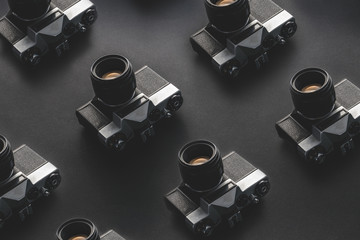 Vintage Film Cameras On Black Background Surface. Creativity Retro Technology Concept