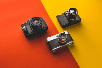 Creativity Retro Technology Concept. Film Cameras On Red And Orange Background, Top View