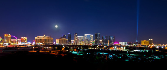 Printed roller blinds Las Vegas A view of the Las Vegas skyline with a full moon shining down.