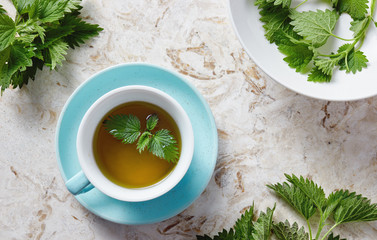 Nettle tea and fresh nettle leaves