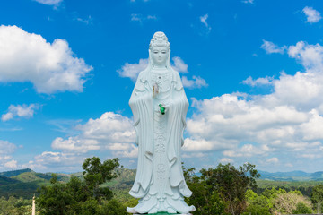 Big Statue of Guanyin on blue sky at Wat Suwan Khiri, Simmulate of Golden Shwedagon Pagoda , Ranong, Thailand