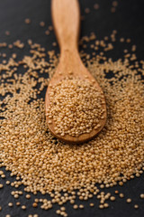 fresh amaranth grains on a rustic background
