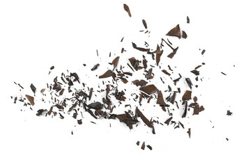 Burned, charred paper scraps isolated on white background, top view