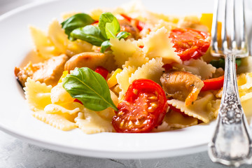 Pasta with chicken and vegetables. Close up.