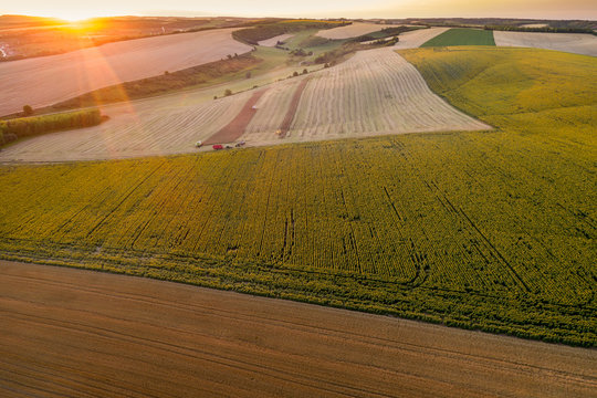aerial photo of working combine