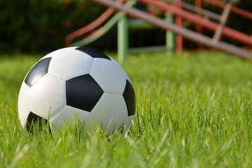 Football or soccer ball on the green grass,outdoor activity.