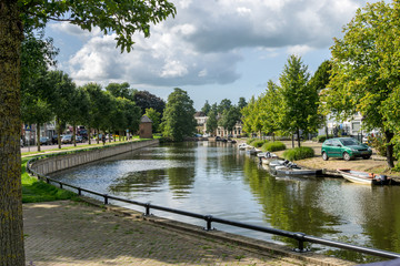 Cityscape of Sneek at Prins Hendrikkade at the Looxmagracht (Looxma canal) in the province Friesland, The Netherlands