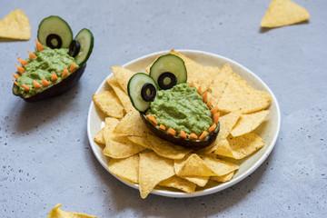 Funny alligator avocado guacamole dip and nachos