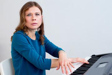 Woman playing synthesizer