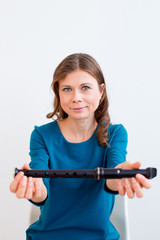 Woman playing on a flute