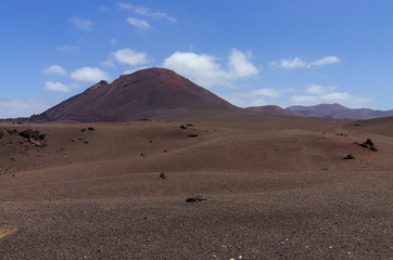Volcanoes near the hiking trail in Timanfaya National Park on Lanzarote, the Canary Islands
