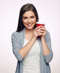 Smilng woman holding red coffee cup.