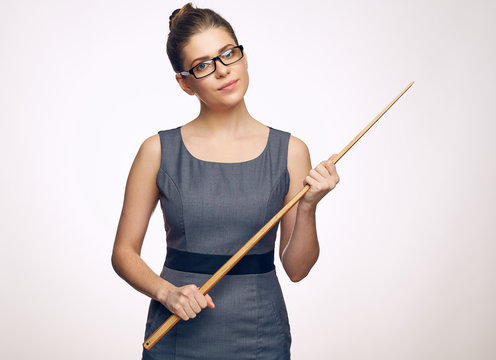 Strict woman teacher wearing glasses. portrait with wooden point