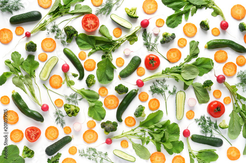 Fototapete Fresh vegetables and greens on a white background. Pattern of vegetables. Radish, carrots, tomatoes, cucumbers, dill isolated on white background. Vegetable background wallpaper.Top view, flat lay.