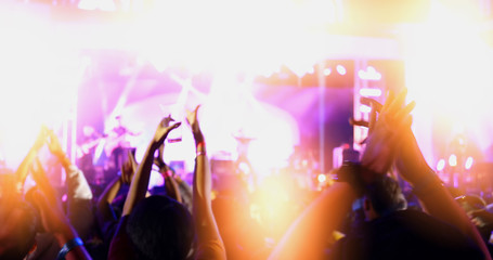 silhouettes of concert crowd in the outdoor,night light and lens flare