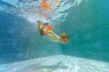 little boy swim underwater