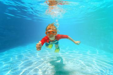 happy little boy swim underwater with thumbs up