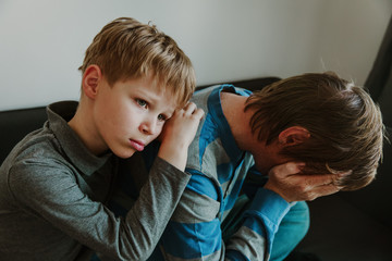 sad child with stressed father, family in sorrow