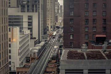 Elevated subway tracks cutting through the middle of an urban area