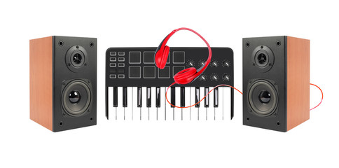 Music and sound - Two loudspeaker enclosure, MIDI keyboard and red headphone. Isolated