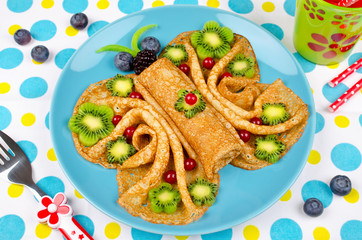 Funny Butterfly face pancakes with berries and fruits for kids' snack food