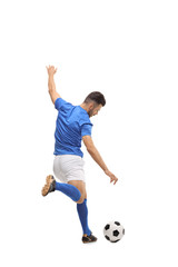 Soccer player kicking a football