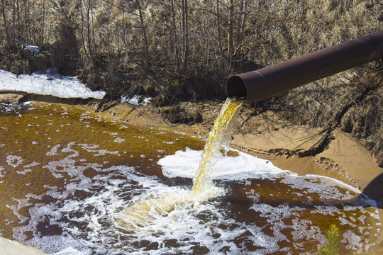 The Industrial Wastewater is Discharged from the Pipe