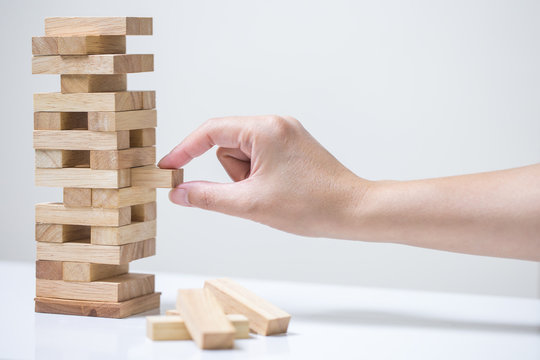 Business risk concept with wood jenga game.