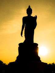 Beautiful picture of biggest buddha statue (Phutthamonthon) in sunset background.