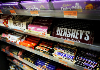Different brands of chocolate bars are stored in racks at a supermarket in Quezon City